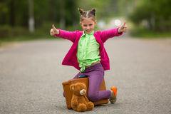 little-traveller-road-suitcase-teddy-bear-happy-72824712